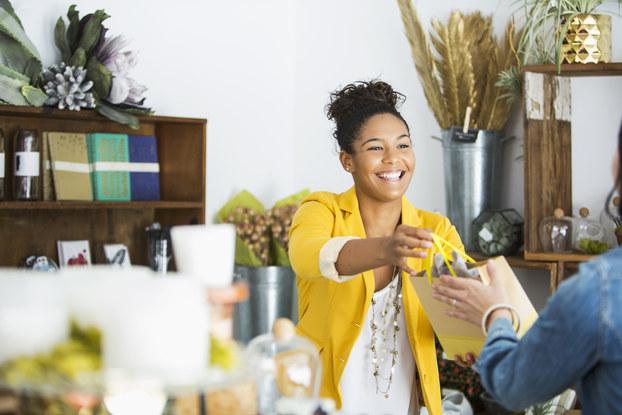 saleswoman helping customer