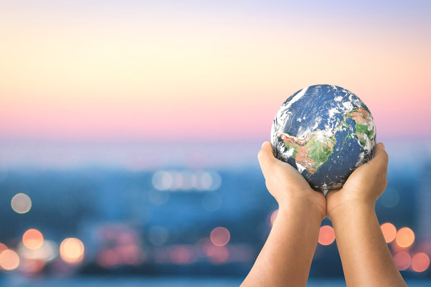 hands holding a small globe