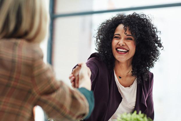 Business women shake hands