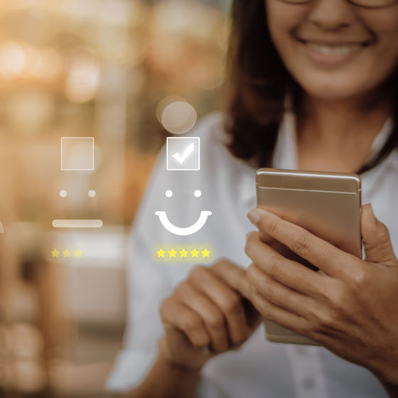 woman holding phone with positive customer service image