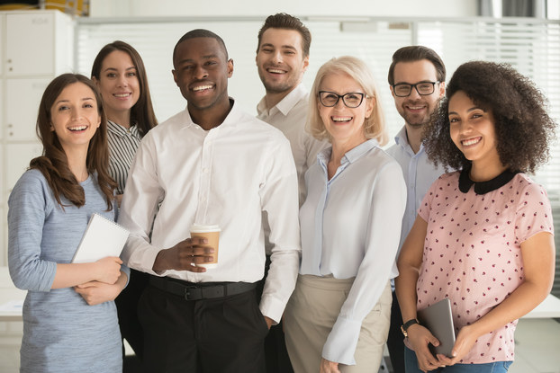 group of employees standing in group