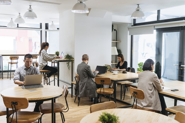 Workers sitting in co-working space