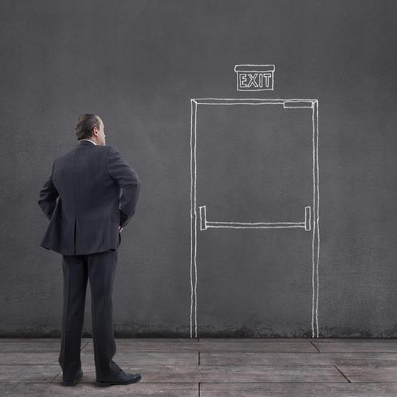 Man staring at exit door