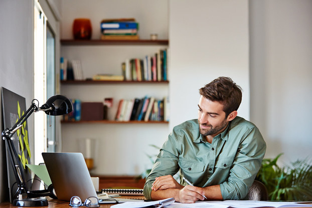 Man working on laptop in home office