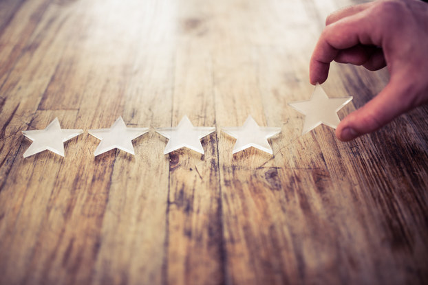 Five stars on wooden table
