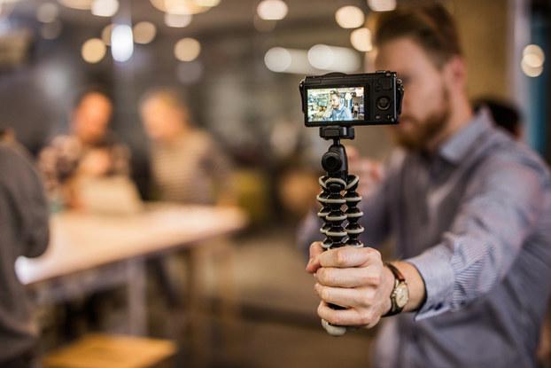Man holding phone recording himself