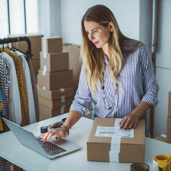 Woman preparing box for shipping
