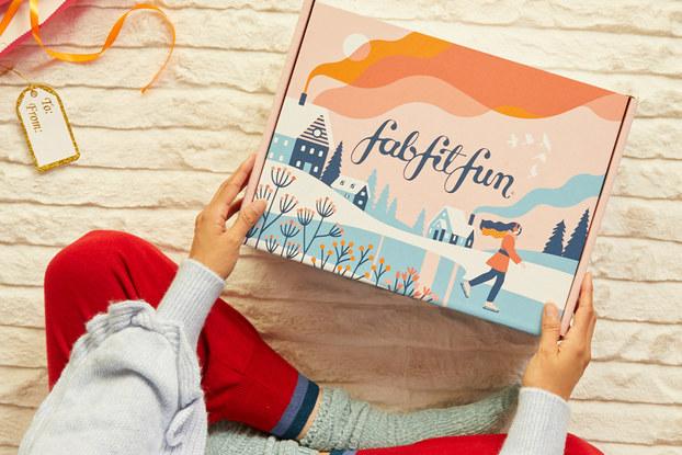 person opening fabfitfun winter box