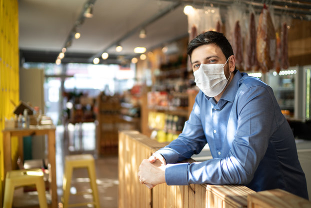 small business owner wearing mask