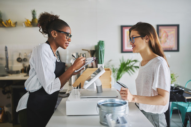 customer at cafe placing order with employee