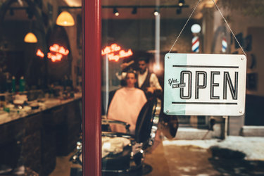 open sign in barber shop window