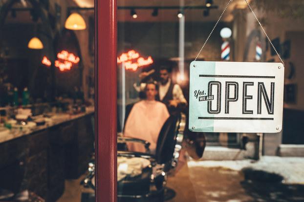 open sign in barber shop window