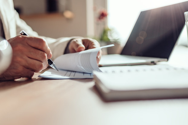 man going through contract at desk