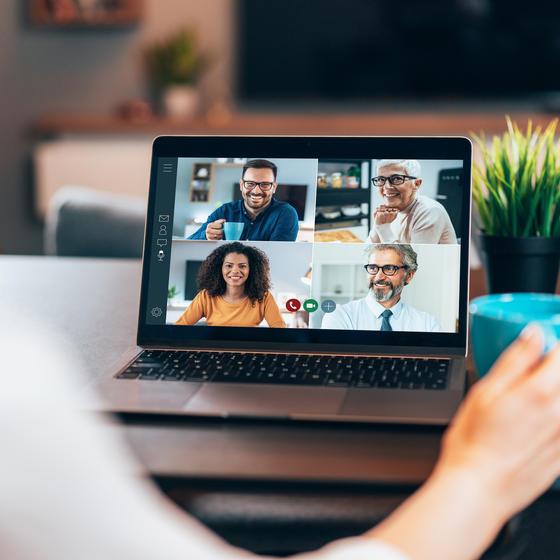 team in virtual meeting on laptop
