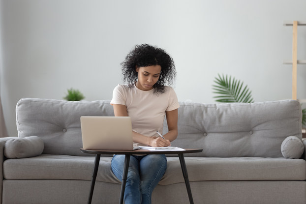 Woman works on document while working from home
