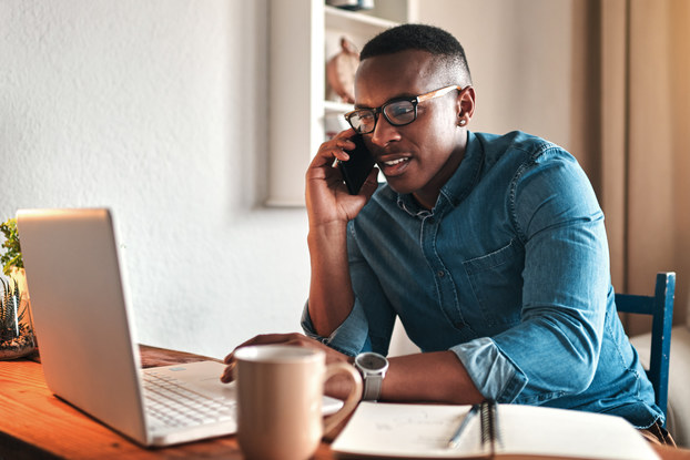 Man uses communication platforms to work from home.