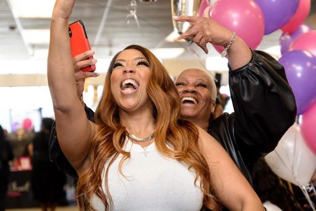 women taking selfie at ashley stewart in-store event