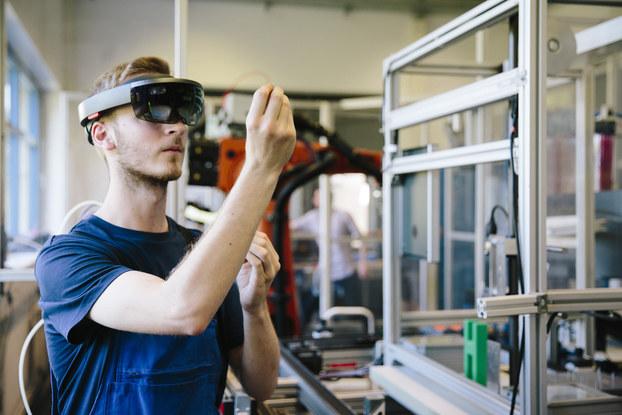Man uses VR at work.