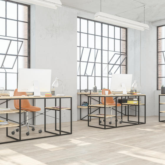 modern office with open windows and socially distanced desks