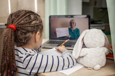 child doing schoolwork on video chat