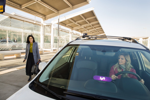woman getting picked up by lyft