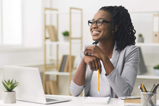 woman sitting at desk smiling