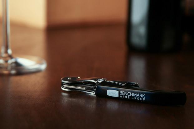 benchmark wine bottle opener on table