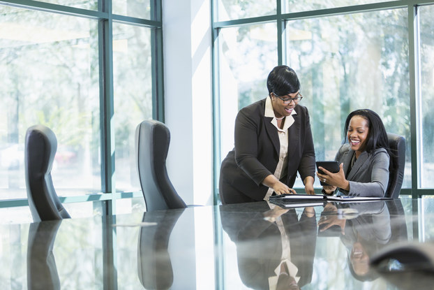 two women in conference room