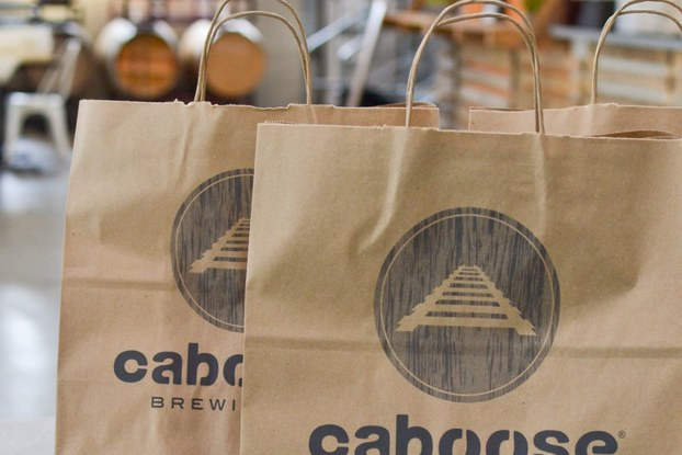 bags with caboose brewing co. branding