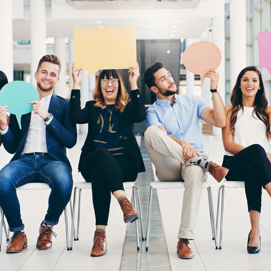 group of young professionals holding speech bubbles