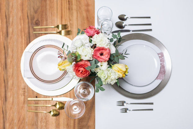 bloomerent flowers on two table settings