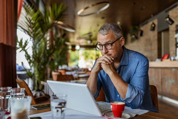 male business owner sitting at table