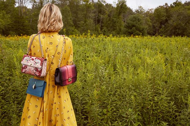 rebag model holding bags