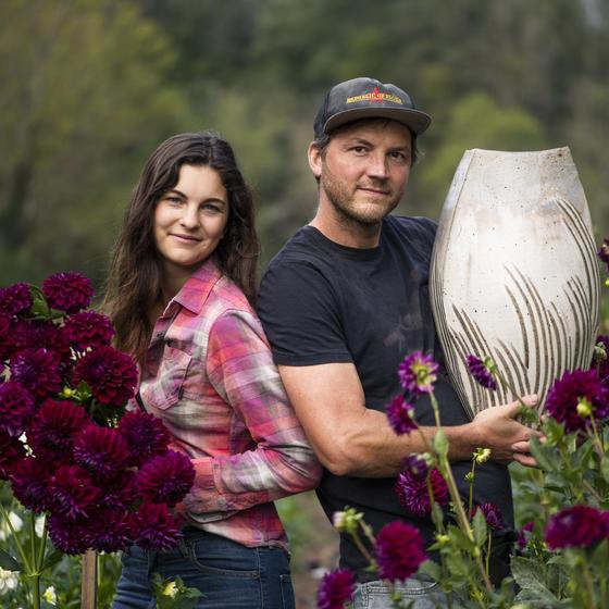 Emily and Josh Copus of Carolina Flowers in their dahlia field.