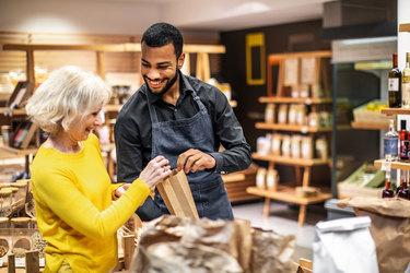 woman talking to male employee in a market