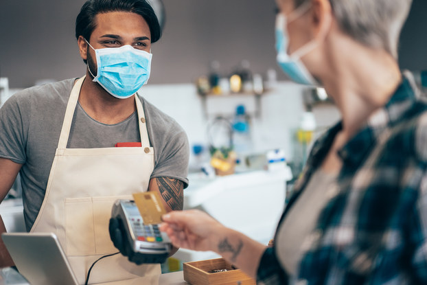 Customer pays for product during COVID-19 pandemic.
