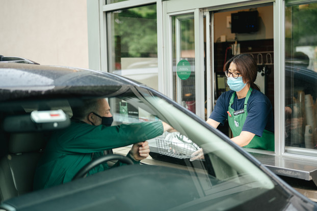 customer at starbucks drive-thru window