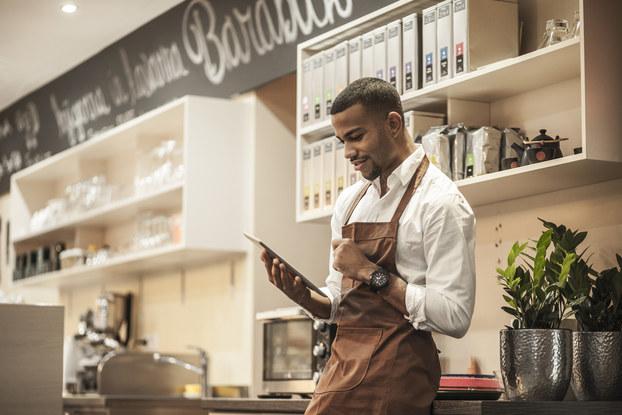 Black business owner in shop