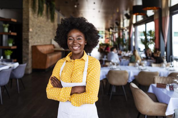 Female business owner in restaurant