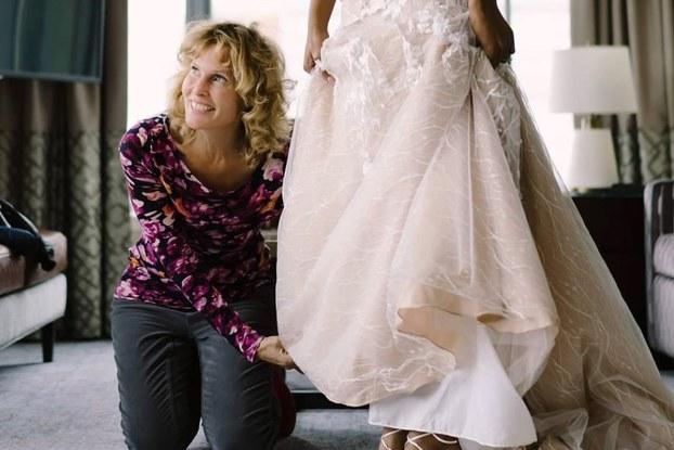 Luba Gankin of primavera dreams touching a wedding dress