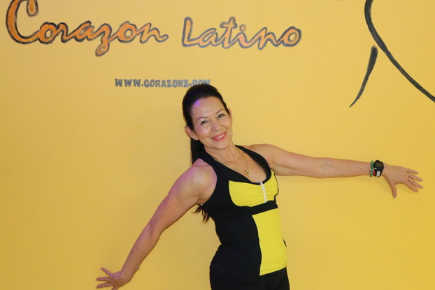 Fanny Gonzalez at studio entrance.