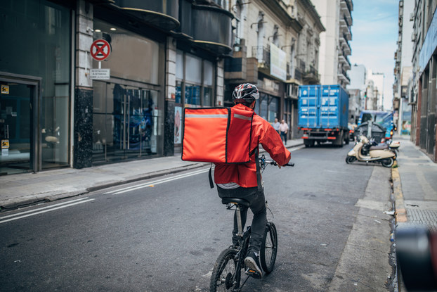 man delivering food on bicycle