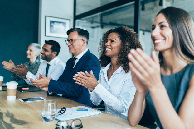 employees clapping while in meeting