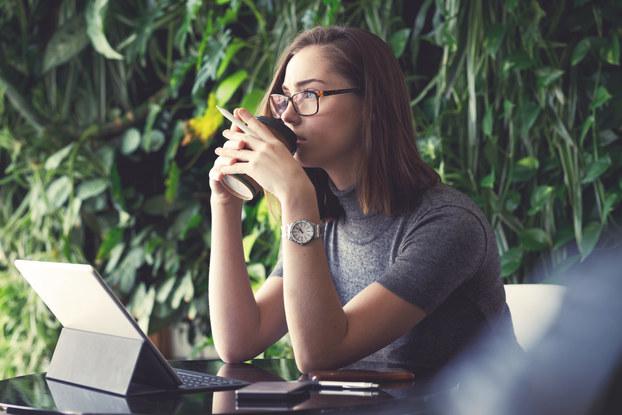 woman at laptop brainstorming