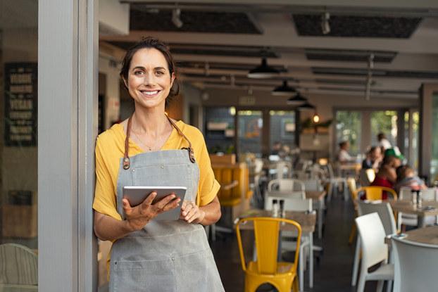 woman business owner standing in doorway