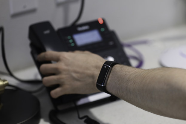 person wearing social distancing wristband by K2