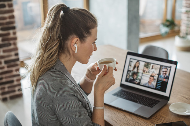 woman sitting at computer on a web conference
