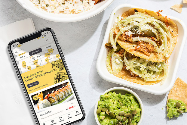seated app on phon screen with takeout food