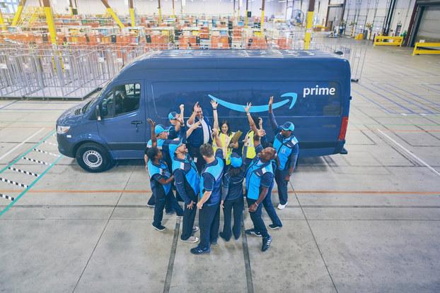 amazon employees in front of van