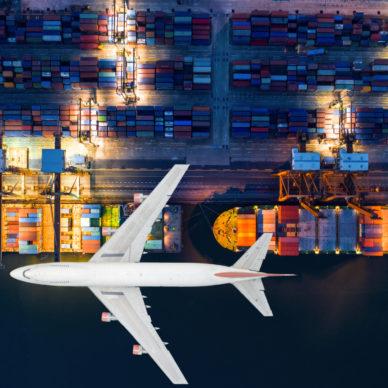 Plane flying over port